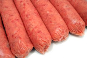 A row of raw beef sausages