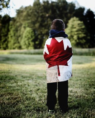 Child wrapped in Canadian Flag