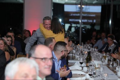 Celebration hug from Jacqueline to Brent for Ontario's Finest Butcher Win